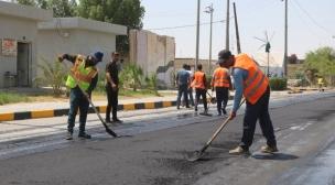 وحدة التنفيذ المباشر في مديرية بلدية النجف تباشر باعمال اكساء شارع الجنسية